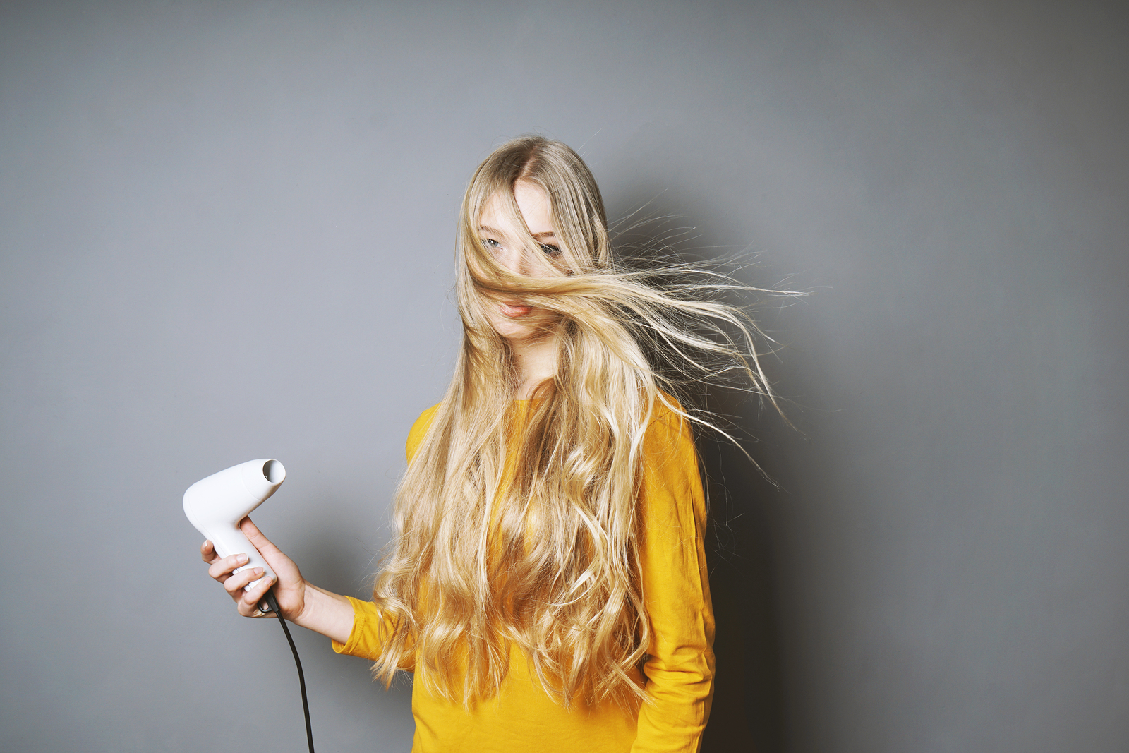 How to Blow Dry Your Hair at Home Like a Pro